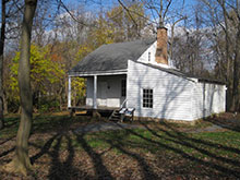 the ca. 1840 Grandma's Cottage with attachedlog cabin addition.  This white clapboard house was moved to the Histopric Blenheim site in 2001.  It had ben owned by Magaret Willcoxon Farr, sister of Alber Willcoxon.